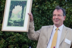 H&HS Chair Marc Hutchinson receives picture to commemorate sheep trial
